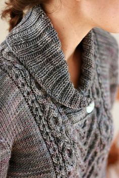 Lovely cable knit sweater. Just crying out for some Posh Yarn.....