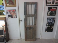 antique architectural salvage wood door with iron bars and bolt latch
