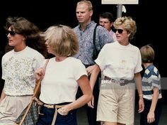 Lady Diana, Princess of Wales (2nd R), and family friends Catherine Soames (L) and Kate Menzies (C) leave the Jim Henson Muppets Pavilion 25 August 1993 during a visit to MGM Studios at Walt Disney World. Prince William is far right, and security personnel in the background are unidentified.