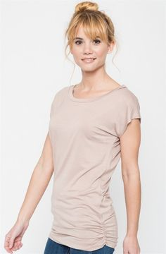 A classic staple that is made out of easy-to-wear fabric. This top speaks elegance on its own. We love a soft, jersey top that can be easily worn with your skinnies or leggings with a touch of detail of a ruched side seam. Case in point: We are obsessed.Available in 7 Colors:  BlackHeather GreyMintPeachTaupeOatmealRoyalThis garment runs true to size: Small (0-4)Medium (6-8)Large (10-12)X-Large (14-16)Model is wearing a size Small.  96% Rayon, 4% Spandex. Made in...