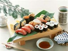 sushi.. considering the fact I'm half japanese, just looking at this makes me HUNGRY and CRAVE IT!!