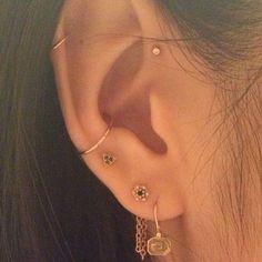 Tendance : les piercings aux oreilles se portent en constellation   Glamour