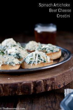 Spinach Artichoke Beer Cheese Crostini with #stonebrewing IPA  http://www.stonebrewing.com/ipa