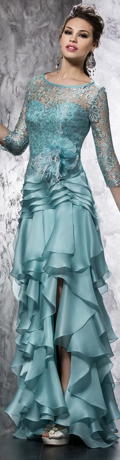High low mother of the bride dresses for the wedding can have tiered ruffles. This teal blue evening gown can be customized when being recreated by our US dress design firm. You can have any dress in a picture made however you like with any changes.  We specialize in affordable custom evening dresses for the mothers of the wedding.  See other options for the #motherofthebride at www.dariuscordell.com