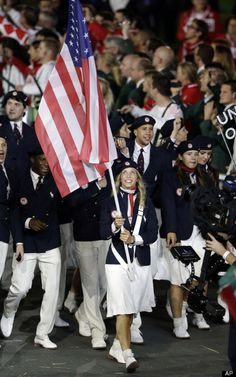Mariel Zagunis, 2 time gold medal winner in fencing, leads Team USA Into Olympic Stadium for the 2012. opening ceremony.