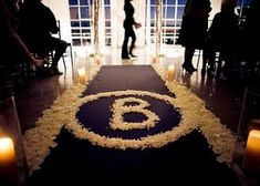 wedding aisle with monogram and candle aisle treatments...Flyboy Naturals Rose Petals offers over 100 colors...something for every palette