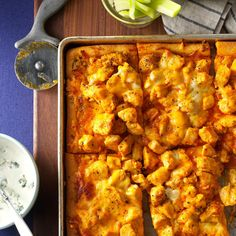 Buffalo Chicken Pizza Recipe -If your family likes spicy chicken wings, they'll love this pizza made with bottled buffalo wing sauce and refrigerated pizza dough. Serve the blue cheese salad dressing on the side so you can drizzle it over each slice. —Shari DiGirolamo, Newton, Pennsylvania