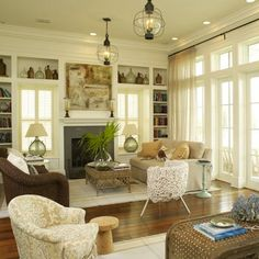 Love the full height white French doors & windows. Built in cabinetry around the fireplace is gorgeous too