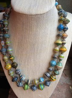 Beautiful paper bead necklace, handmade in Kenya from recycled magazines and silver accents. Fair Trade, recycled, handmade, and beautiful!