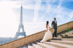 Gorgeous bride and groom walking hand in hand in front of the Eiffel Tower in Paris. Wedding photo captured by Fran Boloni from Kiss me in Paris #wedding #weddinginspiration #bride #groom #paris #eiffel #eiffeltower #parisjetaime