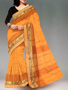 Shop online designer pure handloom dhaka cotton tant saree at unnatisilks.com Peach orange and brown color pure handloom Dhaka cotton tant saree without blouse.This cotton sari has got all over thread weaving bootis along with brown thread woven temple style border on either side.And it has woven stripes elegant pallu.It is suitable for casual and corporate wear. To buy online dhaka handloom cotton sarees please visit our site http://www.unnatisilks.com/