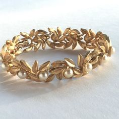 Vintage pearl and goldtone bracelet by Avon.  7 1/2 long  Please email me with any questions that you may have.  Delivery Confirmation and a gift box are included in the shipping charge.