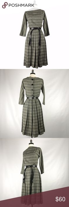 """Vintage 60s Black Glen Plaid Button Back Dress S 1960s vintage black and white box pleat glen plaid belted dress. Dolman sleeve bodice. Fastens with back metal zipper and button back.  Label: Henley Jr Bust: 36"""" - 38"""" Waist: 26"""" Hips: Up to 40"""" Length: 40""""  Good vintage condition. One pull just below the belt in the front (see last photo) Vintage Dresses Midi"""
