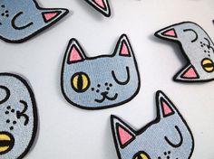 Guiño patch cat - hierro en remiendo - cose en el remiendo - patch cat - gato de…
