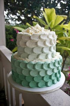 sea foam green ombre buttercream cake with white chocolate shavings