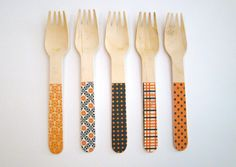Biodegradable wooden utensils with cheery patterns add pop to any party.