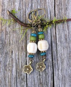 bohemian dangle earrings with indo-pacific glass and antiqued brass.  earthy hippie style. teal blue, olive green, and ivory.