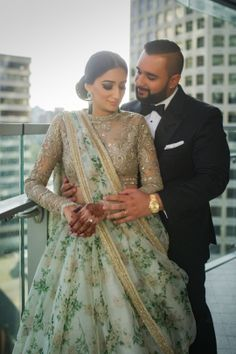 Candid Couple Shot - Vick & Rimple wedding story | WedMeGood | Bride in a Floral Lehenga with a Sequinned Blouse and Groom in a Tuxedo #wedmegood #indianbride #indianwedding #bridal #lehenga #black #floral #tuxedo #sequinned