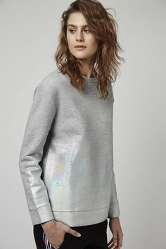 Holographics take the basic sweatshirt up a notch, embrace the look with this ombre foil number. Crafted in a super-soft jersey, we're loving the relaxed silhouette and contemporary vibe. #Topshop