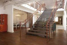 A nod to San Francisco, the stairs are a burnt orange metal with cables for sides (similar to the Golden Gate Bridge). The steps are made of heavy wood timber and have a gorgeous cutout pattern that lets light through. Source:  Jonah Podbereski