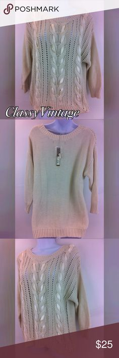 NWT twisted ribbon sweater. The color is turtle dove or cream. The style is vintage charm. Twisted ribbon front and three quarter length sleeves. This is 60% cotton and 40% acrylic. NWT  tag price $50.00 Lauren Conrad Sweaters