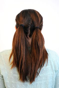 Step two: secure two ponytails — one on each side — towards the back of your head