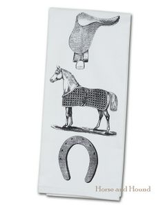 Horse Equipment Kitchen Towel. Large towels perfect for the equestrian kitchen or in the bar. White towel decorated with antique horse wood cut in black. 100% cotton and absorbent. Made in the USA.