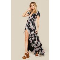"""The Rosa Floral Maxi Dress by the Jetset Diaries features their signature floral print with gorgeous flutter sleeves, lace up back, plunging neckline and wrap front with tie closure.ImportedDry Clean OnlyPolyblendFit Guide:Model is 5ft 7 inches; Bust: 32"""", Waist: 24"""", Hips: 34""""Model is wearing a size XSFully Lined, Hidden Back ZipShoes Featured Not Available For Purchase"""