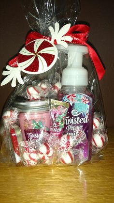 Christmas gift for friends at the gym, hair stylist, teachers, and mail carrier. Twisted Peppermint hand soap, mason jar candle, lip gloss (all Bath & Body Works), Altoids, peppermints. Bath & Body Works lets you take the amount of cellophane bags and ribbon you need. Wrap it up and add a peppermint tag.
