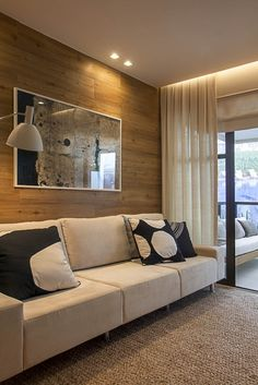 Apartamento Pontal Recreio - www.giseletaranto.com; wood accent wall - looks like laminate