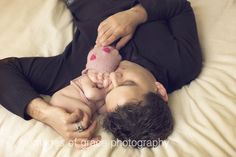 how sweet this daddy is with new baby girl