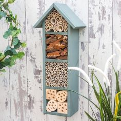 Four Tier Bee Hotel Your garden will soon be buzzing with this great bug house. This insect habitat is ideal for hanging in a sheltered garden, house wall or orchard. It is a general insect habitat that may be used by solitary bees such as Mason Bees o.
