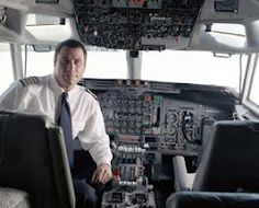 """CELEBRITY COLLECTOR - John Travolta - Aviation related collector. What do you do when your neighbours won't let you park your Boeing 707 outside your home? You move to another """"housing development"""" - one that lets you have close-parking privileges, complete with a 1.4-mile airstrip!    He now live just north of Ocala, Florida. Shown are two of Travolta's jets - a Gulfstream and a Boeing 707B - there aren't very many non-commercial airstrips where planes of that size can take off and land."""