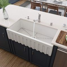 Best Farmhouse Sinks For Sale! Discover the best stainless steel farmhouse sinks, copper farmhouse sinks, cast iron farmhouse sinks, fireclay farmhouse sinks, and more. Fireclay Farmhouse Sink, Fireclay Sink, Farmhouse Sink Kitchen, Farm Sink, Country Kitchen, Kitchen Sink Design, Apron Sink Kitchen, Apron Front Sink, Farmhouse Aprons