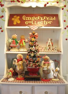 "We're Just hanging around the Christmas tree for now!  20"" Gingerbread Feather Kitchen Christmas Tree by Denise"