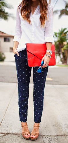 Trousers, white top, red bag and mirrored sunglasses. | Office Style