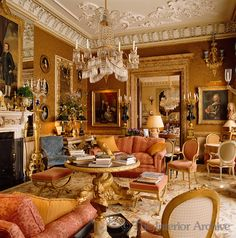 Gilt-framed portraits line the damask-covered walls of this drawing room with a Baltic crystal chandelier hanging from the plasterwork ceiling by Decimus Burton ~ Thomas Kyle & Jerome Murray