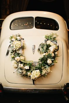 Lovely wreath-adorned getaway car | wedding by Mariee Ami and A Bryan Photo - Southern Weddings Magazine