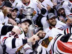 Game 6 in Boston: Blackhawks 3, Bruins 2 -- Chicago Blackhawks players, including Corey Crawford (lower right), pose for a team photo with the Stanley Cup.