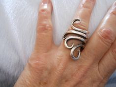 Antique Sterling Silver Fork Ring (I bought a similar one this weekend...I think it's very unique to make jewelry out of utensils!)
