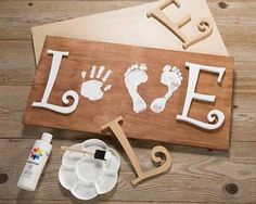 Adorable baby footprint Love board. Inspiration from Craft Warehouse. #diy #love #baby #craftwarehouse craftwarehouse.com