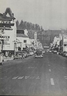 Downtown Eugene with view of Skinner's Butte 1952. The Oregon O is visible. From the 1952 Oregana (University of Oregon yearbook). www.CampusAttic.com