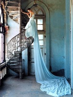 Cool staircase, doorway, and really long dress.