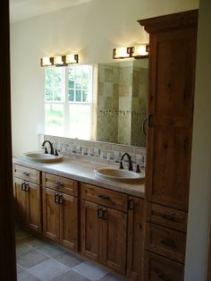 Traditional bathroom with large wall mounted vanity mirror. #designmine