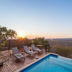 Lounge next to this swimming pool at Bushwa Game Lodge in #Limpopo with a stunning view of the #bushveld! #WanderlustWednesday #TravelGround