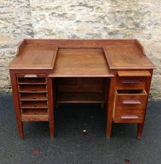 New Arrival: A 1920s Oak Desk with Tambour fronted sliding documents trays, writing slide & drawers