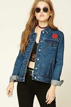 "A denim jacket featuring tiger, rose, and ""World Traveler 1988"" back embroidery, a buttoned front, basic collar, two front flap button pockets, two front slit pockets, two embroidered roses on front, and long sleeves with button cuffs."