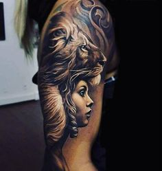 Male Upper Arms Black And White Lion Lady Tattoo