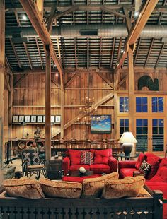 LOVE the Red couches!!! Barn living http://www.cowboysindians.com/Cowboys-Indians/July-2011/Barn-Beauty/