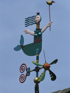 A Colorful Mermaid-Shaped Weather Vane Photographic Print by Darlyne A. Murawski at AllPosters.com